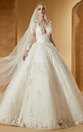 glam Long Sleeve Appliqued Ball Gown Dress With Illusion And Chapel Train