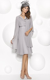 V-neck Knee-length Jersey Dress With Beading And Cape