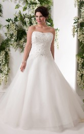 Strapless A-line Tulle Ball Gown With Beaded top And Corset Back