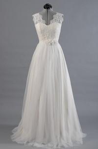 A-Line Alencon Lace Tulle Skirt. Sleeveless V-Neckline Dress